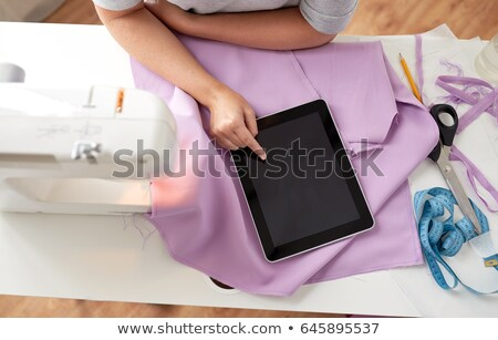 tailor with sewing machine, tablet pc and fabric Stock photo © dolgachov