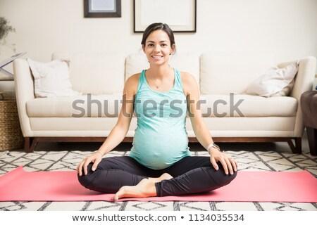 Souriant femme enceinte séance fitness méditation regarder Photo stock © deandrobot