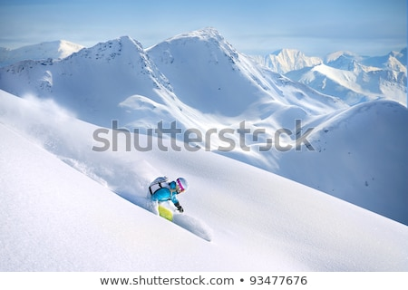 female snowboarder turning off piste stock photo © is2