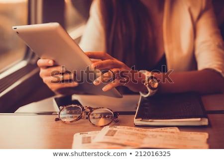 Traveler woman using tablet computer. Stock photo © artfotodima