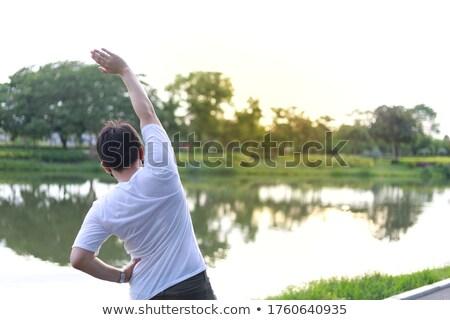 Zdjęcia stock: Człowiek · obok · jezioro · charakter · fitness