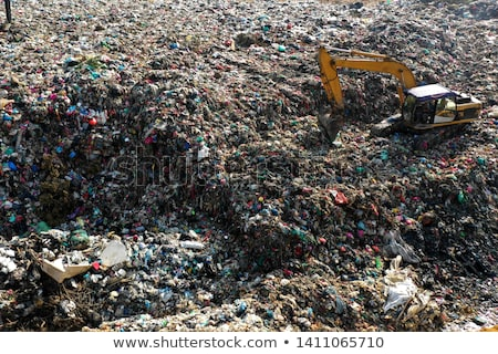 People disposing waste materials and garbage in a landfill site  Stock photo © Kzenon