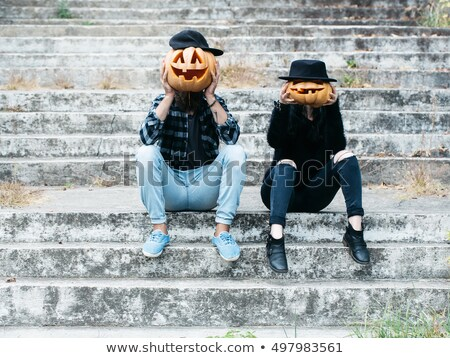 man and woman with pumpkin on halloween stock photo © is2