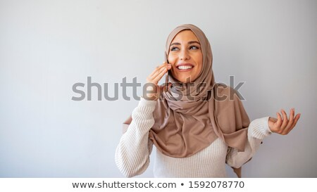 Arabic woman with suitcase talking on phone stock photo © studioworkstock