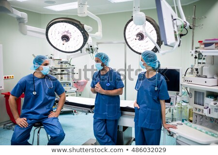 surgeons interacting with each other in operation theater stock photo © wavebreak_media