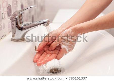 Stockfoto: Woman Washing Her Hands Under Running Water
