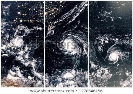 Stock photo: A Menacing Line Of Hurricanes Elements Of This Image Are Furnished By Nasa