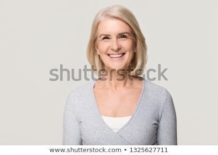 portrait of a woman blonde on a light background stock photo © dmitriisimakov