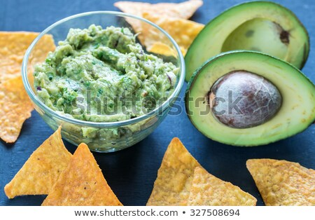 Guacamole in the glass bowl with tortilla chips Stock photo © Alex9500