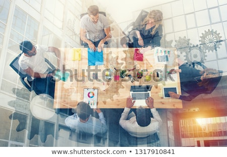 Team of business person works together on company statistics. Concept of teamwork. Double exposure Stock photo © alphaspirit