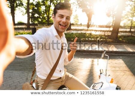 Izgatott fiatal üzletember sétál kint moped Stock fotó © deandrobot