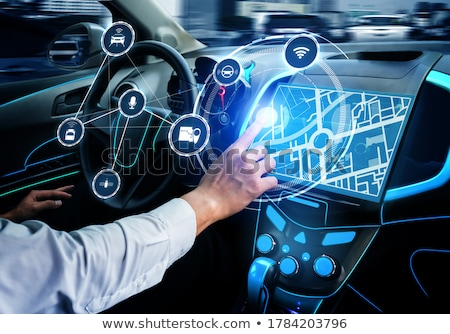 man using the navigation system of a car Stock photo © nito