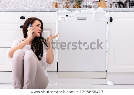 üzücü kadın oturma bulaşık makinesi çağrı Stok fotoğraf © AndreyPopov