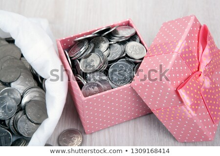 open pink gift box with russian ruble coins and a bag with coins stock photo © mizar_21984
