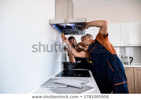 Male Worker Fixing Kitchen Hood With Screwdriver Stock photo © AndreyPopov