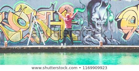 Homem desenhar novo grafite parede Foto stock © jossdiim