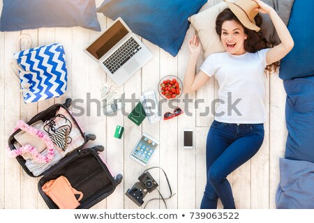 Top view of an excited young girl in summer hat Stock photo © deandrobot