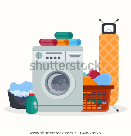 Laundry room service concept. Working washing machine with linen baskets, detergent, ironing board a Stock photo © makyzz