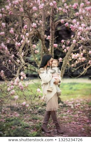 anya · tanít · kicsi · lánygyermek · dolgozik · laptop - stock fotó © elenabatkova