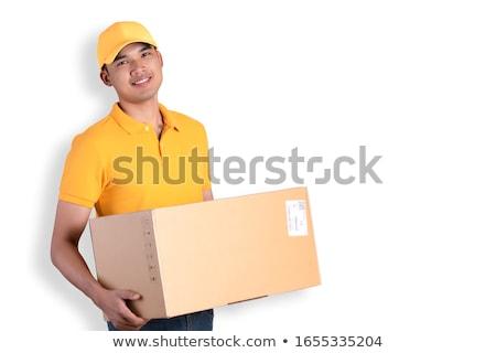 мужчины курьер равномерный глядя почты коробки Сток-фото © Kzenon