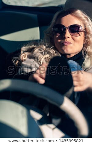 Impatient young woman tying laces while driving Stock photo © Giulio_Fornasar
