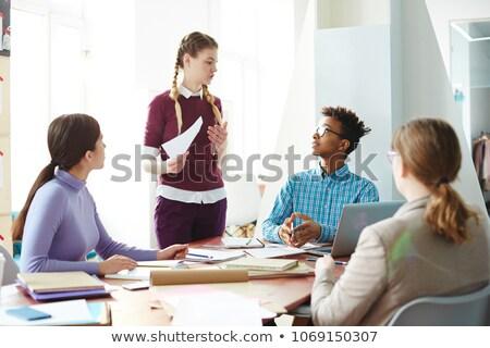 Group of intercultural college students preparing for seminar Stock photo © pressmaster