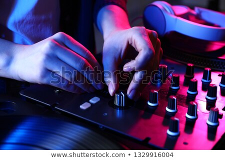 female DeeJay hands on a DJ modern console Stock photo © Giulio_Fornasar