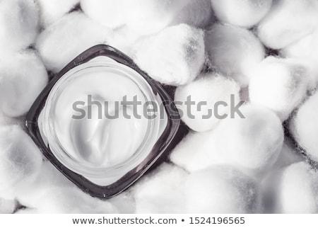 Luxury face cream for sensitive skin and white cotton balls on b Stock photo © Anneleven