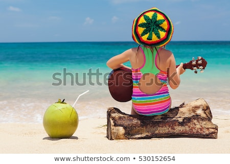 Woman playing in ocean paradise beach travel destination Stock photo © lovleah
