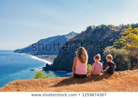 Woman relaxing on a cliff with scenic views Stock photo © lovleah