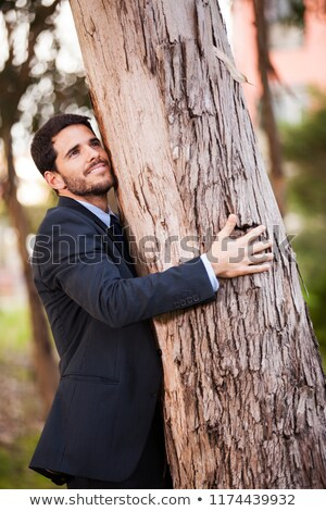 Businessman hugging tree Stock photo © leeser