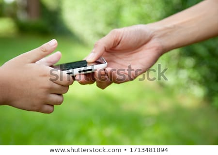 Mother lend a hand to her son Stock photo © pekour