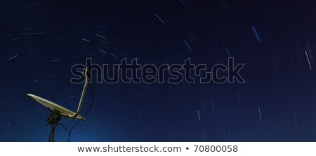 Conceptual Of Yellow Satellite Over Spiral Star At Night Stok fotoğraf © vichie81