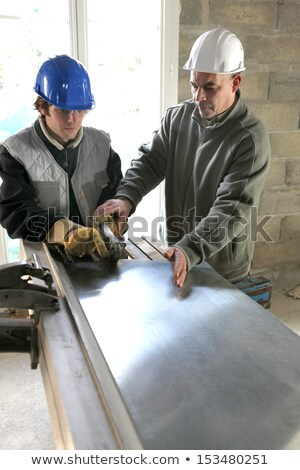 apprentice being shown how to cut sheet metal stock photo © photography33
