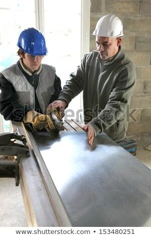 Aprendiz cortar folha metal trabalhar indústria Foto stock © photography33