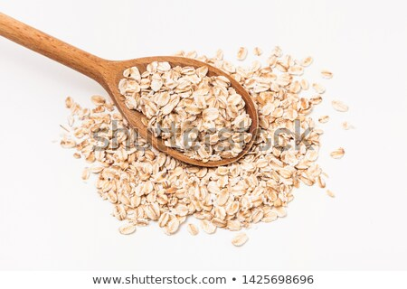 Oat meal cereal mixed in wooden spoon  Stock photo © zhekos