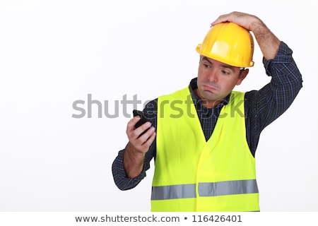 workman with fluorescent safety jacket looks puzzled Stock photo © photography33