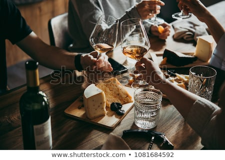 Friends celebrating with a glass of wine Stock photo © photography33