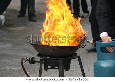 Hand over a smoke alarm Stock photo © photography33