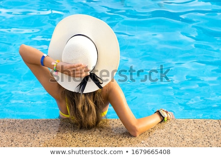 Woman relaxing at a poolside Stock photo © photography33