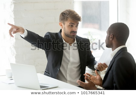 Angry Business Man in Suit Gesturing Get Lost Stock photo © scheriton