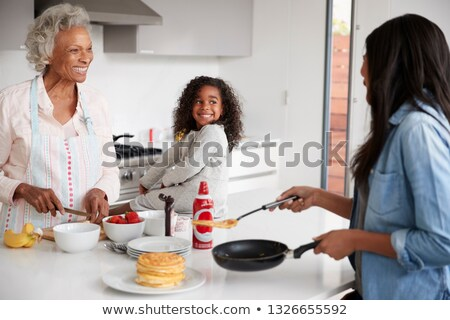 Three generations cooking pancakes Stock photo © photography33