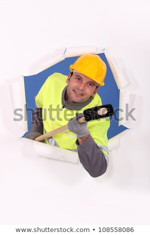 Construction worker breaking through a barrier with a mallet Stock photo © photography33
