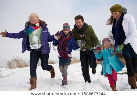 Laughing woman appearing through snow Stock photo © stryjek