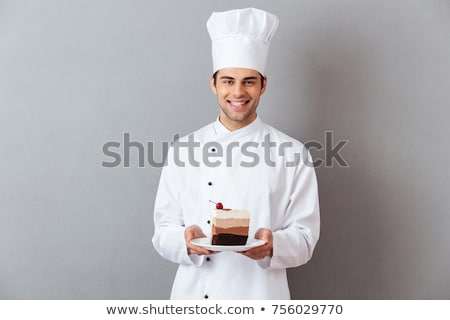 Happy young chef holding plate of pastry Stock photo © wavebreak_media