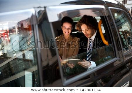 Negócio colegas juntos táxi táxi Foto stock © stockyimages
