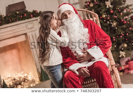 santa claus sitting at home with family   little girl and her mo stock photo © hasloo