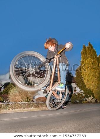 boy with dirtbike is going airborne  Stock photo © meinzahn