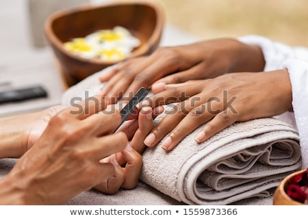Woman with beautiful manicured finger nails Stock photo © AndreyPopov