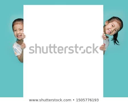 ludzi · biznesu · patrząc · za · billboard · portret · uśmiechnięty - zdjęcia stock © rob_stark